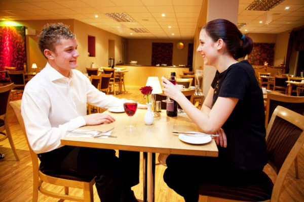 Two people eating in a restaurant
